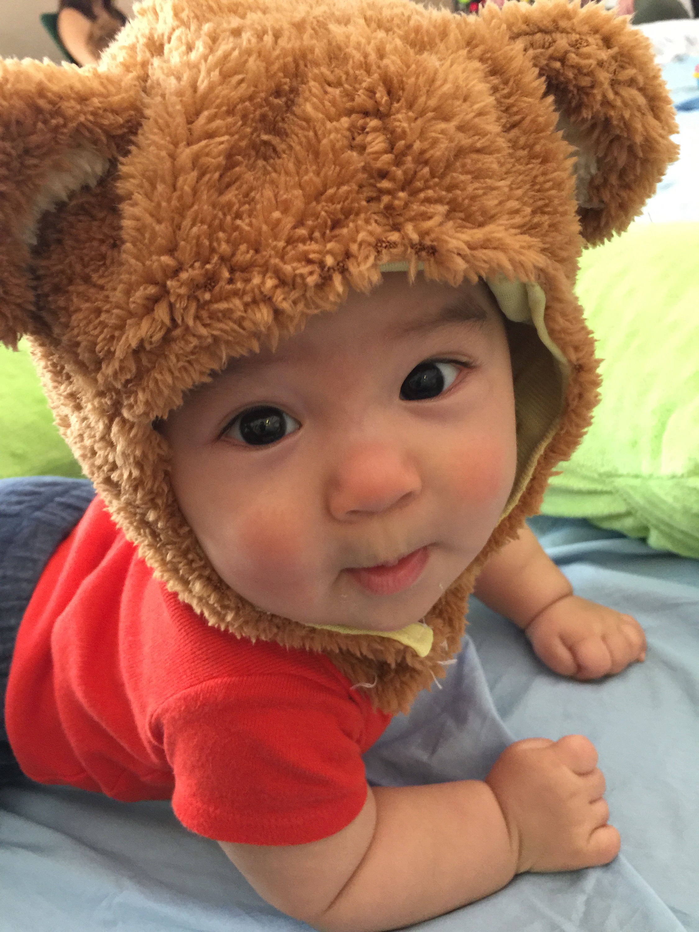 A baby with a bear head
