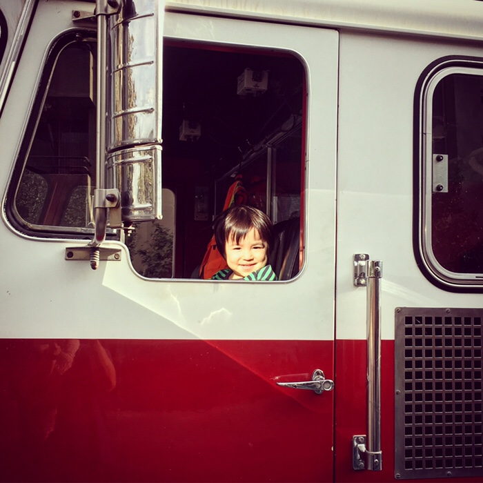 He got to ride on the fire truck! They came to our condo to check our fire alarms.